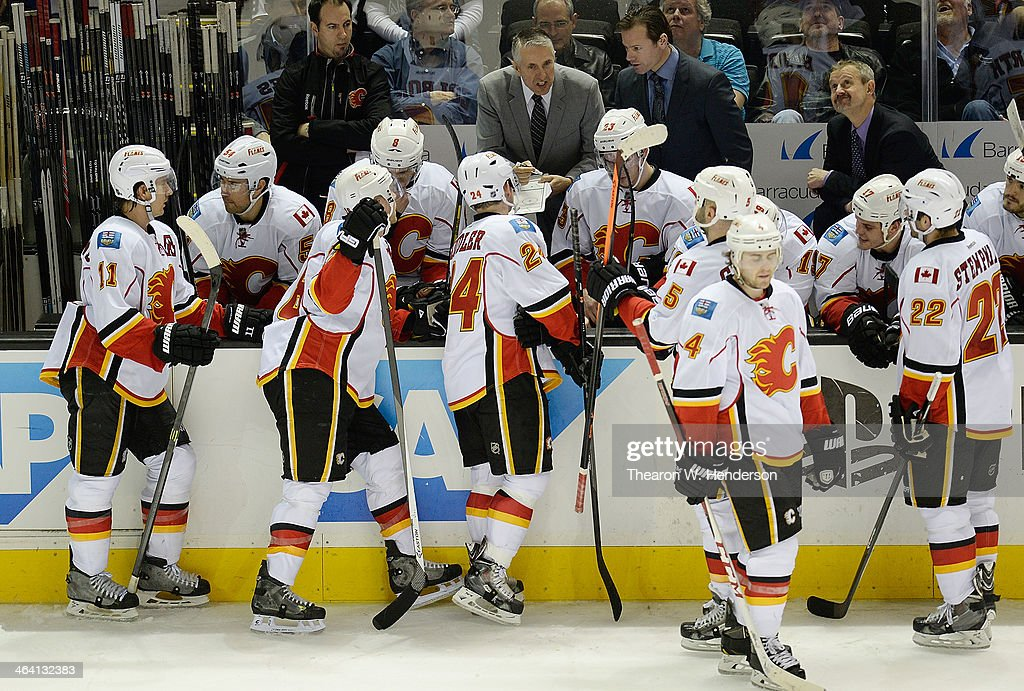 Head coach <a gi-track='captionPersonalityLinkClicked' href=/galleries/search?phrase=Bob+Hartley&family=editorial&specificpeople=206645 ng-click='$event.stopPropagation()'>Bob Hartley</a> of the Calgary Flames draws up a play for his team late in the third period against the San Jose Sharks at SAP Center on January 20, 2014 in San Jose, California. The Sharks won the game 3-2.