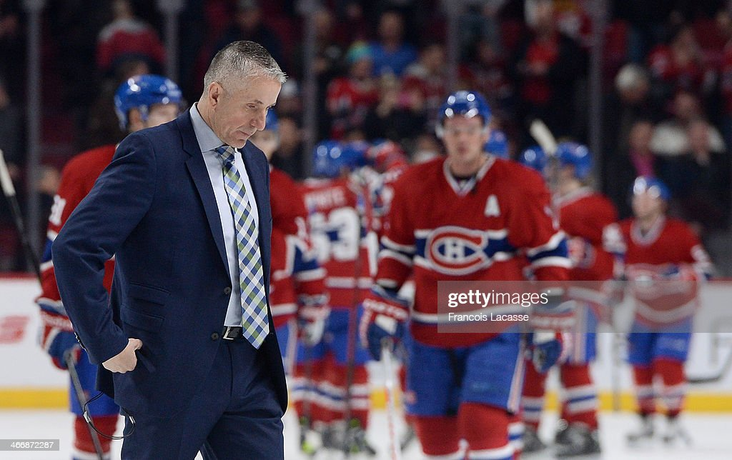 Head coach <a gi-track='captionPersonalityLinkClicked' href=/galleries/search?phrase=Bob+Hartley&family=editorial&specificpeople=206645 ng-click='$event.stopPropagation()'>Bob Hartley</a> of the Calgary Flames walks off the ice after a loss against the Montreal Canadiens during the NHL game on February 4, 2014 at the Bell Centre in Montreal, Quebec, Canada.