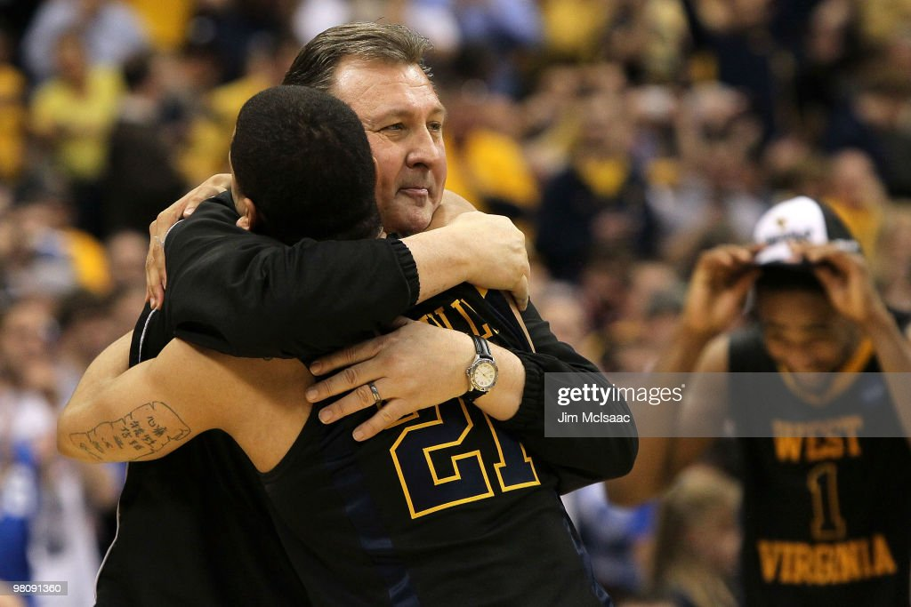 Head coach <a gi-track='captionPersonalityLinkClicked' href=/galleries/search?phrase=Bob+Huggins&family=editorial&specificpeople=2230174 ng-click='$event.stopPropagation()'>Bob Huggins</a> and Joe Mazzulla #21 of the West Virginia Mountaineers celebrate after they won 73-66 against the Kentucky Wildcats during the east regional final of the 2010 NCAA men's basketball tournament at the Carrier Dome on March 27, 2010 in Syracuse, New York.