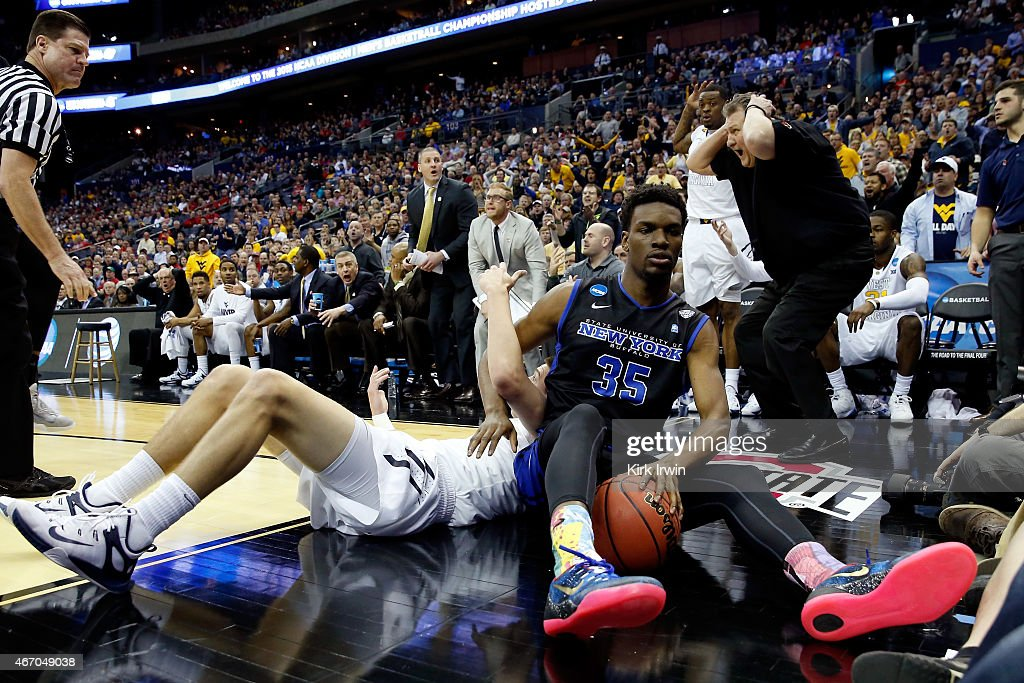 Head coach <a gi-track='captionPersonalityLinkClicked' href=/galleries/search?phrase=Bob+Huggins&family=editorial&specificpeople=2230174 ng-click='$event.stopPropagation()'>Bob Huggins</a> of the West Virginia Mountaineers reacts as a foul is called after Xavier Ford #35 of the Buffalo Bulls and Nathan Adrian #11 of the West Virginia Mountaineers get tangled going for the ball in the first half during the second round of the 2015 NCAA Men's Basketball Tournament at Nationwide Arena on March 20, 2015 in Columbus, Ohio.
