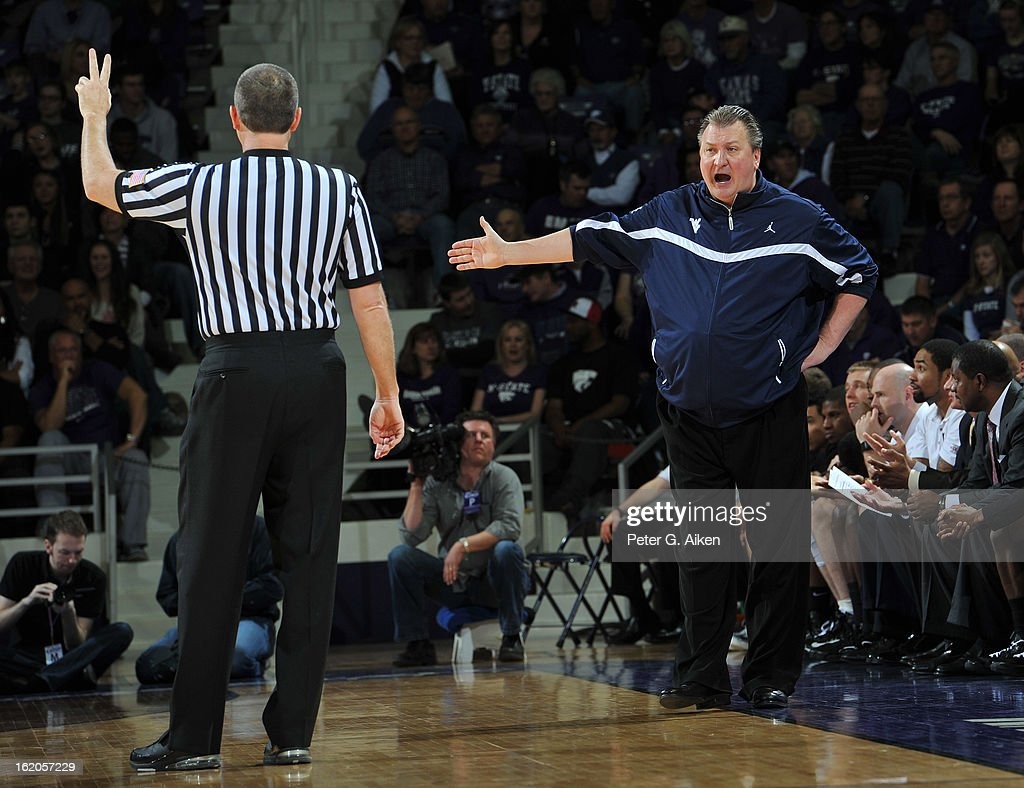 Head coach Bob Huggins (R) of the West Virginia Mountaineers reacts to a call against the Kansas State Wildcats during the first half on February 18, 2013 at Bramlage Coliseum in Manhattan, Kansas. Kansas State defeated West Virginia 71-61.