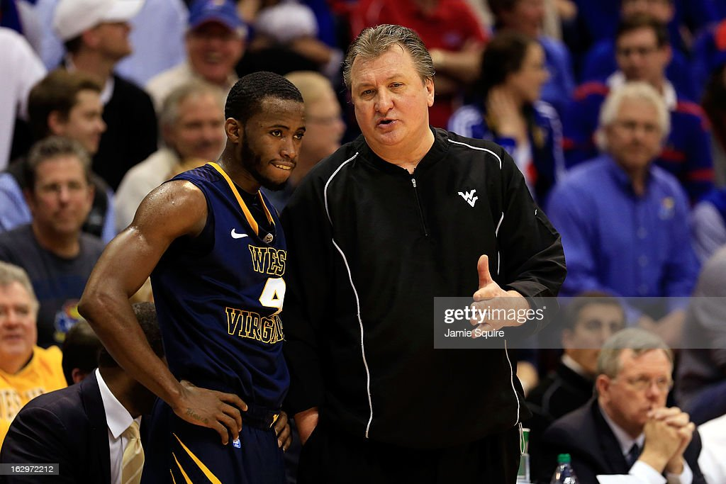 Head coach <a gi-track='captionPersonalityLinkClicked' href=/galleries/search?phrase=Bob+Huggins&family=editorial&specificpeople=2230174 ng-click='$event.stopPropagation()'>Bob Huggins</a> of the West Virginia Mountaineers talks with Jabarie Hinds #4 during the game against the Kansas Jayhawks at Allen Fieldhouse on March 2, 2013 in Lawrence, Kansas.