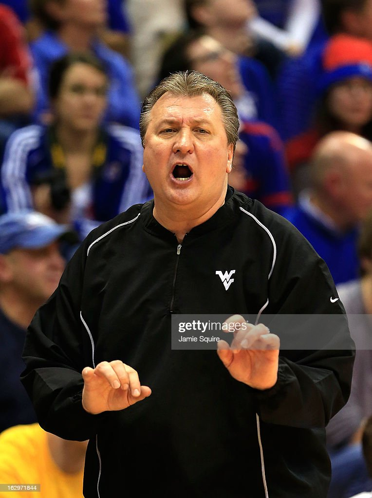 Head coach <a gi-track='captionPersonalityLinkClicked' href=/galleries/search?phrase=Bob+Huggins&family=editorial&specificpeople=2230174 ng-click='$event.stopPropagation()'>Bob Huggins</a> of the West Virginia Mountaineers watches from the bench during the game against the Kansas Jayhawks at Allen Fieldhouse on March 2, 2013 in Lawrence, Kansas.