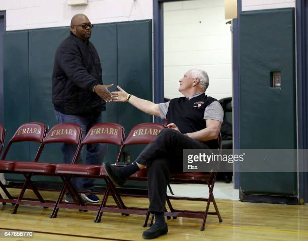 Head coach Bob Hurley of St Anthony Friars is greeted by a fan before the game against the Monclair Immaculate Lions during the 2017 NJSIAA Boy's...