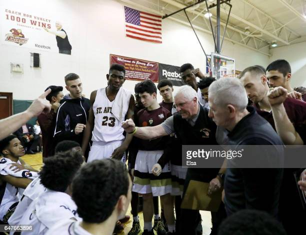 Head coach Bob Hurley of the St Anthony Friars talks with his players during a time out in the second half against the Monclair Immaculate Lions...