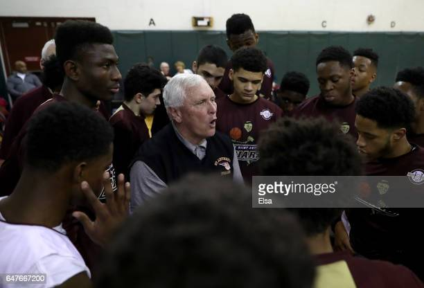 Head coach Bob Hurley of the St Anthony Friars talks with his players before the game against the Monclair Immaculate Lions during the 2017 NJSIAA...