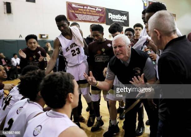 Head coach Bob Hurley of the St Anthony Friars talks with his players during a time out in the first half against the Monclair Immaculate Lions...