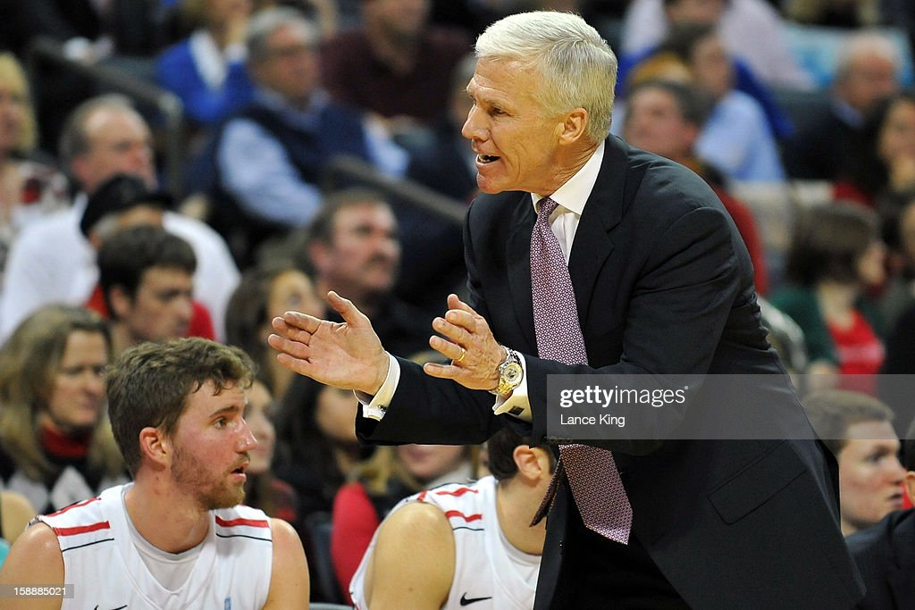 Head Coach Bob McKillop of the Davidson Wildcats encourages his team during a game against the Duke Blue Devils at Time Warner Cable Arena on January 2, 2013 in Charlotte, North Carolina. Duke defeated Davidson 67-50.