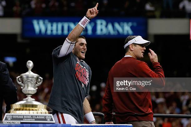 Head coach Bob Stoops and MVP Trevor Knight of the Oklahoma Sooners celebrate after their 4531 win over the Alabama Crimson Tide during the Allstate...