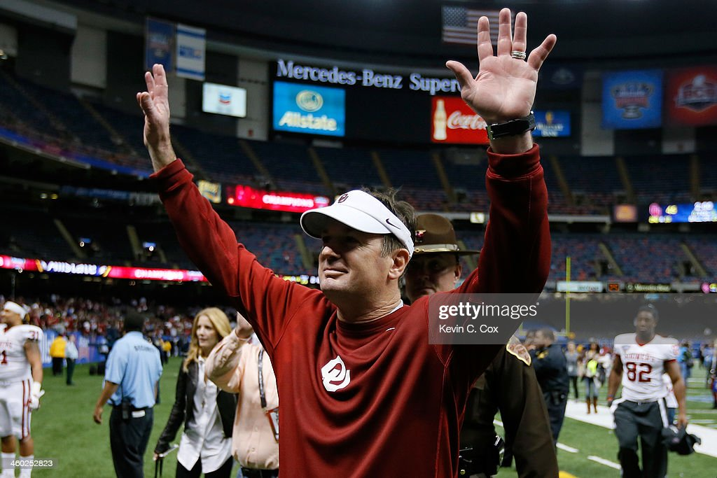 Head coach <a gi-track='captionPersonalityLinkClicked' href=/galleries/search?phrase=Bob+Stoops&family=editorial&specificpeople=241307 ng-click='$event.stopPropagation()'>Bob Stoops</a> celebrates after defeating the Alabama Crimson Tide 45-31 in the Allstate Sugar Bowl at the Mercedes-Benz Superdome on January 2, 2014 in New Orleans, Louisiana.
