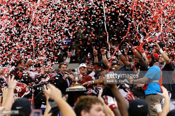 Head coach Bob Stoops of the Oklahoma Sooners celebrates with the winner's trophy after defeating the Alabama Crimson Tide 4531 during the Allstate...
