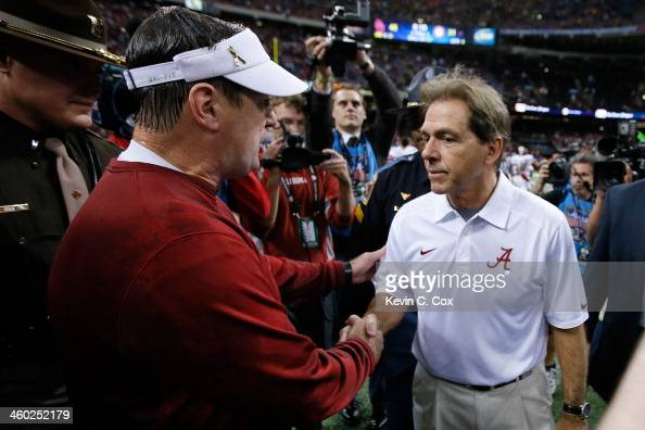 Head coach Bob Stoops of the Oklahoma Sooners is congratulated by Nick Saban head coach of the Alabama Crimson Tide during the Allstate Sugar Bowl at...
