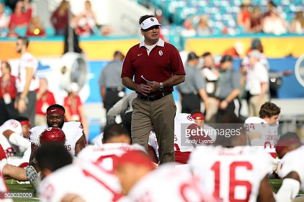 Head coach Bob Stoops of the Oklahoma Sooners looks on prior to the 2015 Capital One Orange Bowl against the Clemson Tigers at Sun Life Stadium on...