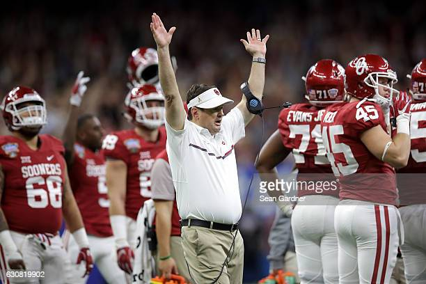 Head coach Bob Stoops of the Oklahoma Sooners reacts after a touchdown against the Auburn Tigers during the Allstate Sugar Bowl at the MercedesBenz...