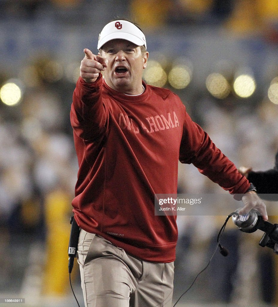 Head coach <a gi-track='captionPersonalityLinkClicked' href=/galleries/search?phrase=Bob+Stoops&family=editorial&specificpeople=241307 ng-click='$event.stopPropagation()'>Bob Stoops</a> of the Oklahoma Sooners reacts to a call during the game against the West Virginia Mountaineers on November 17, 2012 at Mountaineer Field in Morgantown, West Virginia.