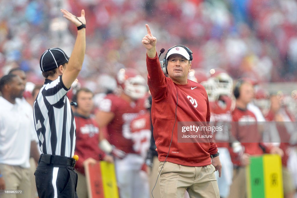 Head coach <a gi-track='captionPersonalityLinkClicked' href=/galleries/search?phrase=Bob+Stoops&family=editorial&specificpeople=241307 ng-click='$event.stopPropagation()'>Bob Stoops</a> of the Oklahoma Sooners tries to direct the referee to the scoreboard during their win against the Texas Tech Red Raiders on October 26, 2013 at Gaylord Family Oklahoma Memorial Stadium in Norman, Oklahoma.
