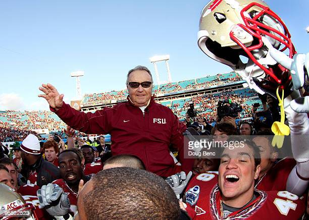 Head coach Bobby Bowden of the Florida State Seminoles is carried off the field by his players after defeating the West Virginia Mountaineers during...