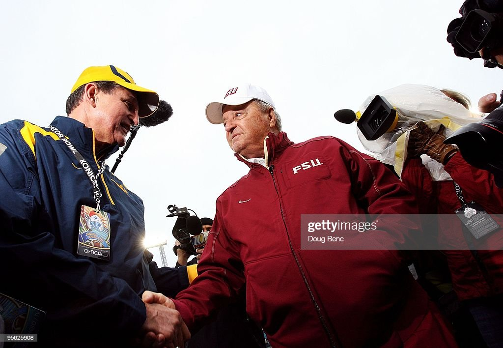 Head coach <a gi-track='captionPersonalityLinkClicked' href=/galleries/search?phrase=Bobby+Bowden&family=editorial&specificpeople=226728 ng-click='$event.stopPropagation()'>Bobby Bowden</a> of the Florida State Seminoles is greeted by the Governor of West Virginia, <a gi-track='captionPersonalityLinkClicked' href=/galleries/search?phrase=Joe+Manchin&family=editorial&specificpeople=568465 ng-click='$event.stopPropagation()'>Joe Manchin</a> III, before taking on the West Virginia Mountaineers during the Konica Minolta Gator Bowl on January 1, 2010 at Jacksonville Municipal Stadium in Jacksonville, Florida. Florida State defeated West Virginia 33-21 in <a gi-track='captionPersonalityLinkClicked' href=/galleries/search?phrase=Bobby+Bowden&family=editorial&specificpeople=226728 ng-click='$event.stopPropagation()'>Bobby Bowden</a>'s last game as a head coach for the Seminoles.