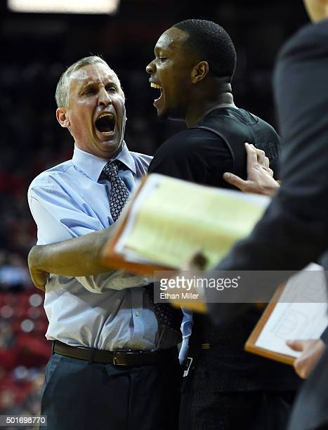 Head coach Bobby Hurley of the Arizona State Sun Devils celebrates with Willie Atwood on the bench late in the team's 6656 win over the UNLV Rebels...