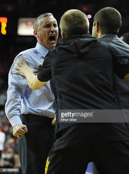 Head coach Bobby Hurley of the Arizona State Sun Devils celebrates with his bench late in the team's 6656 win over the UNLV Rebels at the Thomas Mack...