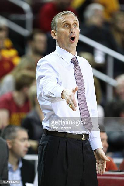 Head coach Bobby Hurley of the Arizona State Sun Devils directs his team against the USC Trojans during a NCAA Pac12 college basketball game at Galen...