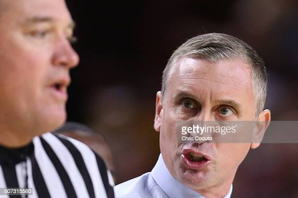 Head coach Bobby Hurley of the Arizona State Sun Devils talks with official Mark Whitehead during the first half of the college basketball game at...