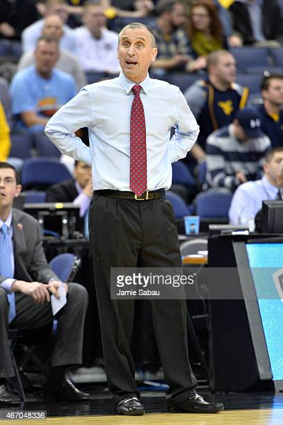 Head coach Bobby Hurley of the Buffalo Bulls looks on from the sideline in the first half against the West Virginia Mountaineers during the second...