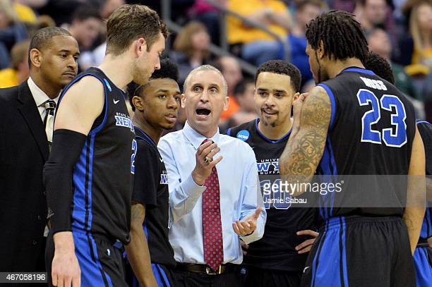 Head coach Bobby Hurley of the Buffalo Bulls speaks to his players in the second half against the West Virginia Mountaineers during the second round...