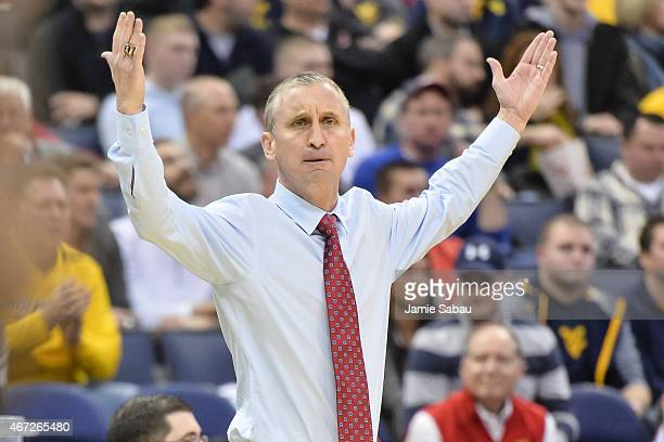 Head Coach Bobby Hurley of the Buffalo Bulls watches his team play against the West Virginia Mountaineers during the second round of the 2015 NCAA...