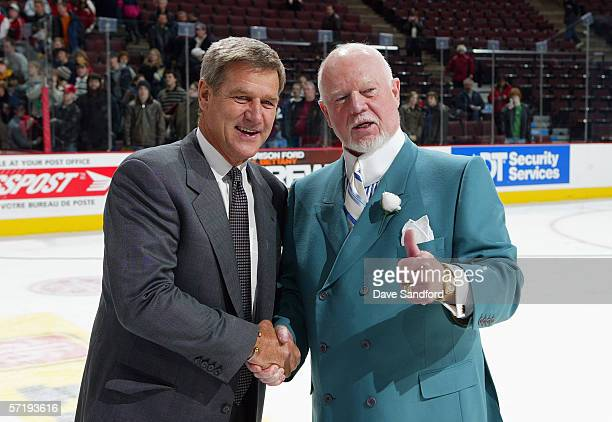 Head coach Bobby Orr of Team Orr smiles and head coach Don Cherry of Team Cherry shake hands after Orr's team won the CHL Top Prospects game 72 at...