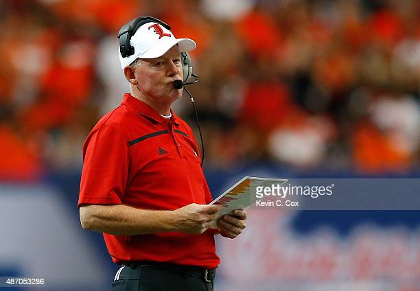 Head coach Bobby Petrino of the Louisville Cardinals looks on during the game against the Auburn Tigers at Georgia Dome on September 5 2015 in...