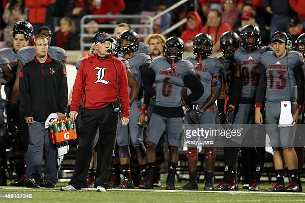 Head coach Bobby Petrino of the Louisville Cardinals looks on from the sidelines against the Florida State Seminoles during their game at Papa John's...
