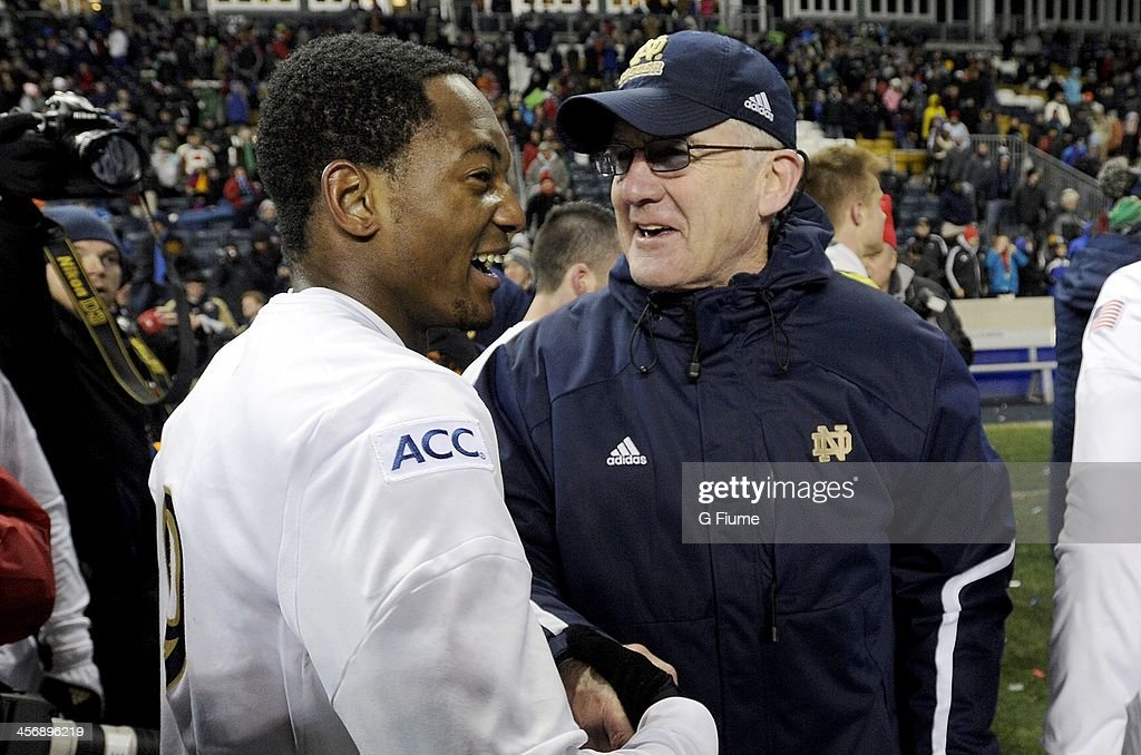 Head coach Boby Clark of the Notre Dame Fighting Irish celebrates with Leon Brown #9 after a 2-1 victory against the Maryland Terrapins during the 2013 NCAA Men's College Cup at PPL Park on December 15, 2013 in Chester, Pennsylvania.