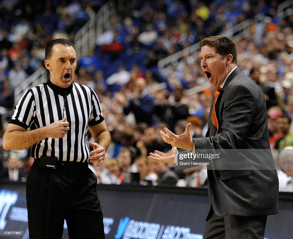 Head coach <a gi-track='captionPersonalityLinkClicked' href=/galleries/search?phrase=Brad+Brownell&family=editorial&specificpeople=805140 ng-click='$event.stopPropagation()'>Brad Brownell</a> of the Clemson Tigers argues a call with official Roger Ayers during a loss to the Duke Blue Devils during the quarterfinals of the 2014 Men's ACC Basketball Tournament at Greensboro Coliseum on March 14, 2014 in Greensboro, North Carolina. Duke won 63-62.