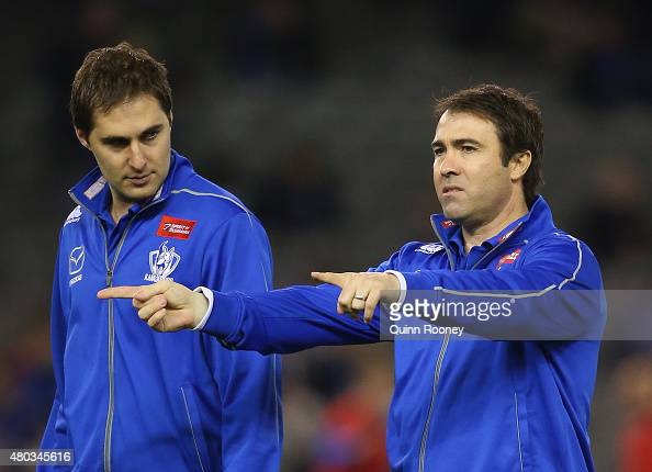 Head coach Brad Scott of the Kangaroos looks on during the round 15 AFL match between the North Melbourne Kangaroos and the Geelong Cats at Etihad...