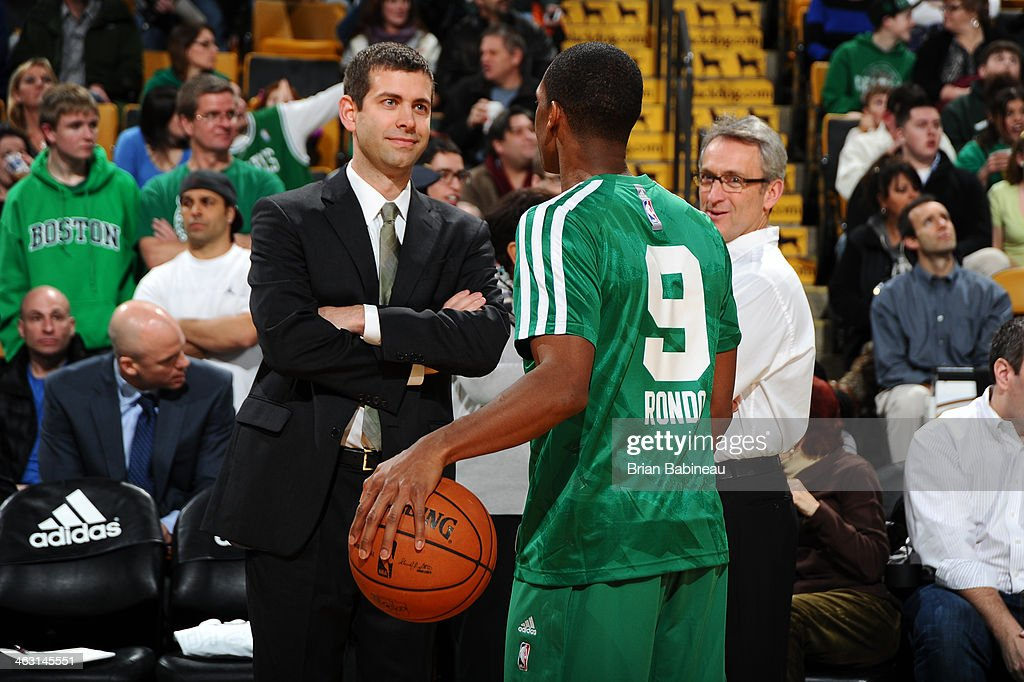 Head coach <a gi-track='captionPersonalityLinkClicked' href=/galleries/search?phrase=Brad+Stevens&family=editorial&specificpeople=5022542 ng-click='$event.stopPropagation()'>Brad Stevens</a> and <a gi-track='captionPersonalityLinkClicked' href=/galleries/search?phrase=Rajon+Rondo&family=editorial&specificpeople=206983 ng-click='$event.stopPropagation()'>Rajon Rondo</a> #9 of the Boston Celtics chat during warm ups before the game against the Toronto Raptors on January 15, 2014 at the TD Garden in Boston, Massachusetts.