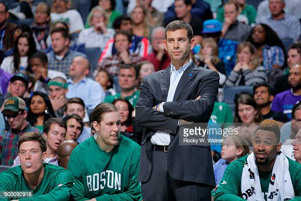 Head coach Brad Stevens of the Boston Celtics coaches against the Charlotte Hornets on December 23 2015 at Time Warner Cable Arena in Charlotte North...