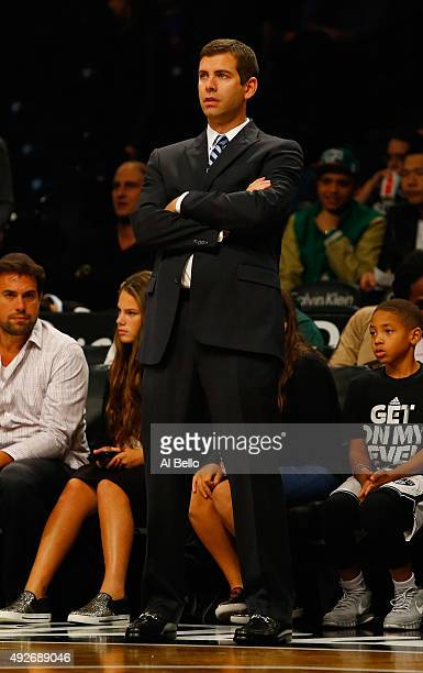 Head Coach Brad Stevens of the Boston Celtics looks on against the Brooklyn Nets during their Preseason game at Barclays Center on October 14 2015 in...