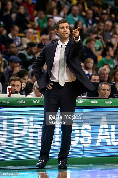 Head coach Brad Stevens of the Boston Celtics looks on from the bench in the first half against the Brooklyn Nets during a preseason game at TD...
