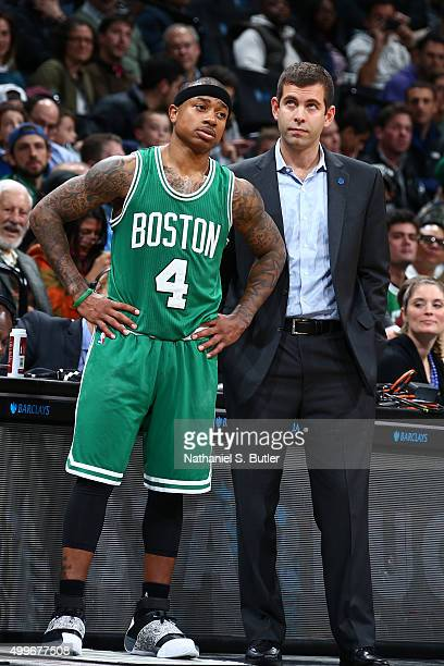 Head coach Brad Stevens of the Boston Celtics speaks with Isaiah Thomas during the game against the Brooklyn Nets on November 22 2015 at Barclays...
