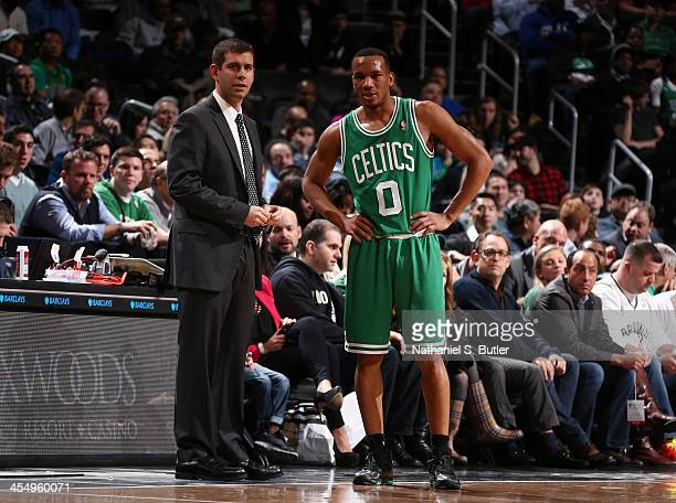 Head Coach Brad Stevens of the Boston Celtics talks with Avery Bradley during a game against the Brooklyn Nets at Barclays Center on December 10 2013...