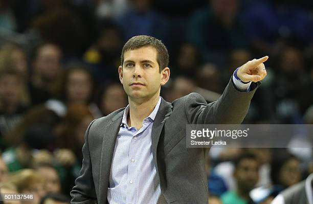 Head coach Brad Stevens of the Boston Celtics watches on during their game against the Charlotte Hornets at Time Warner Cable Arena on December 12...