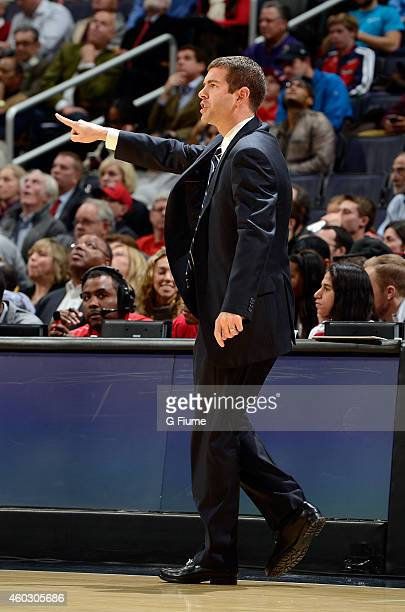 Head coach Brad Stevens of the Boston Celtics watches the game against the Washington Wizards at the Verizon Center on December 8 2014 in Washington...
