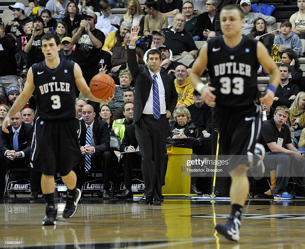 Head coach <a gi-track='captionPersonalityLinkClicked' href=/galleries/search?phrase=Brad+Stevens&family=editorial&specificpeople=5022542 ng-click='$event.stopPropagation()'>Brad Stevens</a> of the Butler Bulldogs directs his team against the Vanderbilt Commodores at Memorial Gym on December 29, 2012 in Nashville, Tennessee.