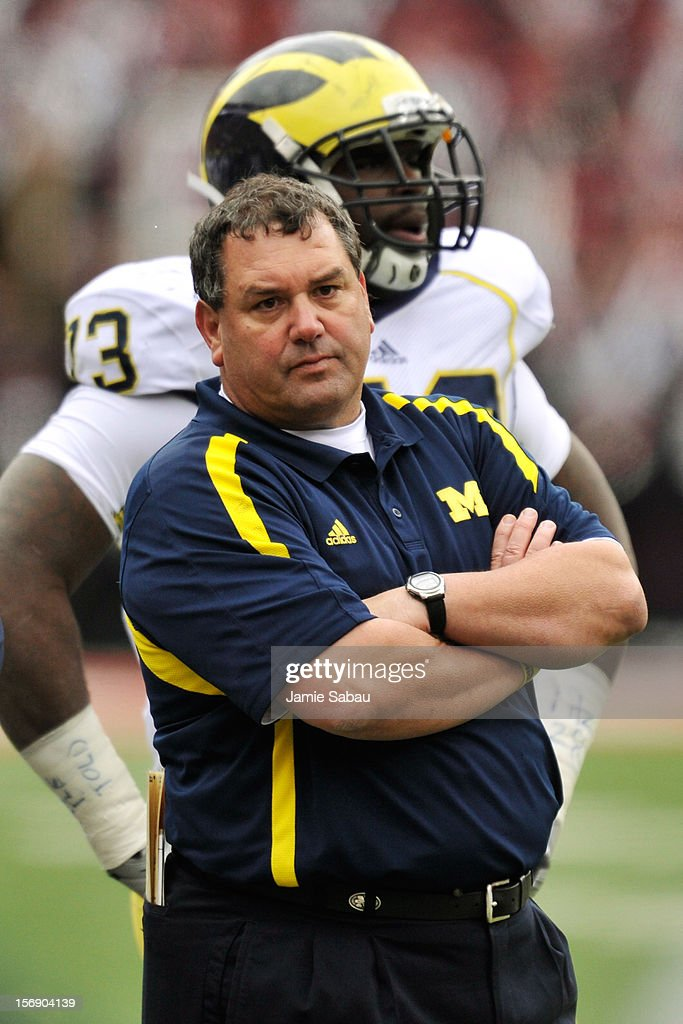 Head coach <a gi-track='captionPersonalityLinkClicked' href=/galleries/search?phrase=Brady+Hoke&family=editorial&specificpeople=3821056 ng-click='$event.stopPropagation()'>Brady Hoke</a> of the Michigan Wolverines watches his team play the Ohio State Buckeyes at Ohio Stadium on November 24, 2012 in Columbus, Ohio. Ohio State defeated Michigan 26-21.