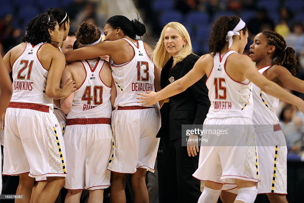 Head Coach Brenda Frese of the Maryland Terrapins looks on as her team celebrates against the Wake Forest Demon Deacons during the quarterfinals of the 2013 Women's ACC Tournament at the Greensboro Coliseum on March 8, 2013 in Greensboro, North Carolina.