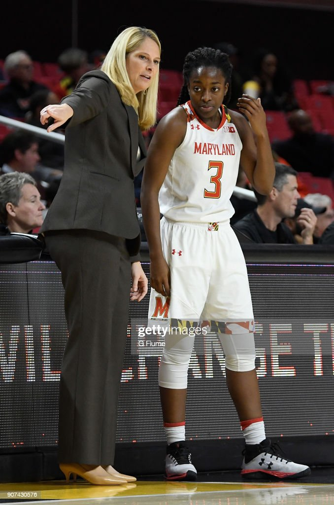 Head Coach Brenda Frese of the Maryland Terrapins talks with Channise Lewis #3 during the game against the Mount St. Mary's Mountaineers at Xfinity Center on December 6, 2017 in College Park, Maryland.