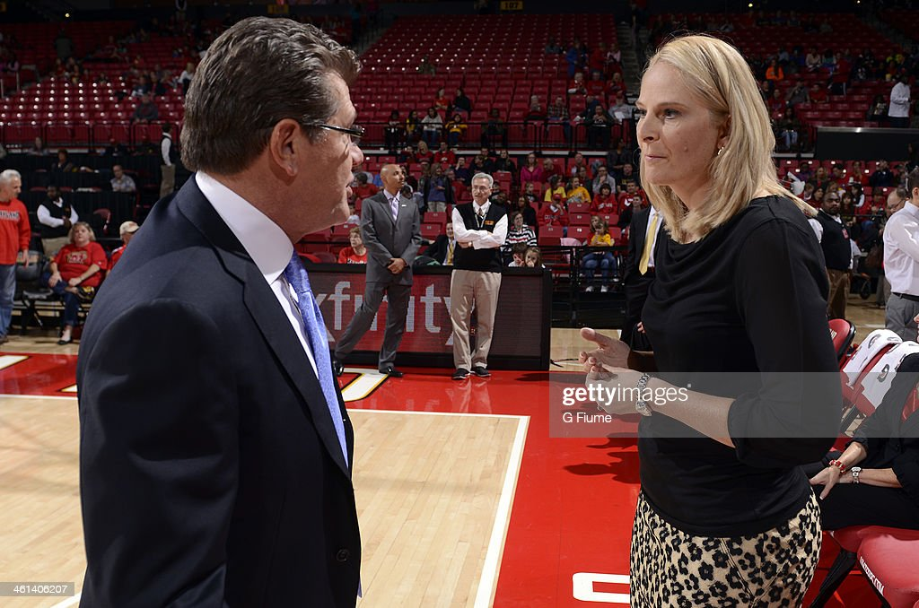 Head coach Brenda Frese of the Maryland Terrapins talks with head coach Geno Auriemma of the Connecticut Huskies before the game at the Comcast Center on November 15, 2013 in College Park, Maryland.
