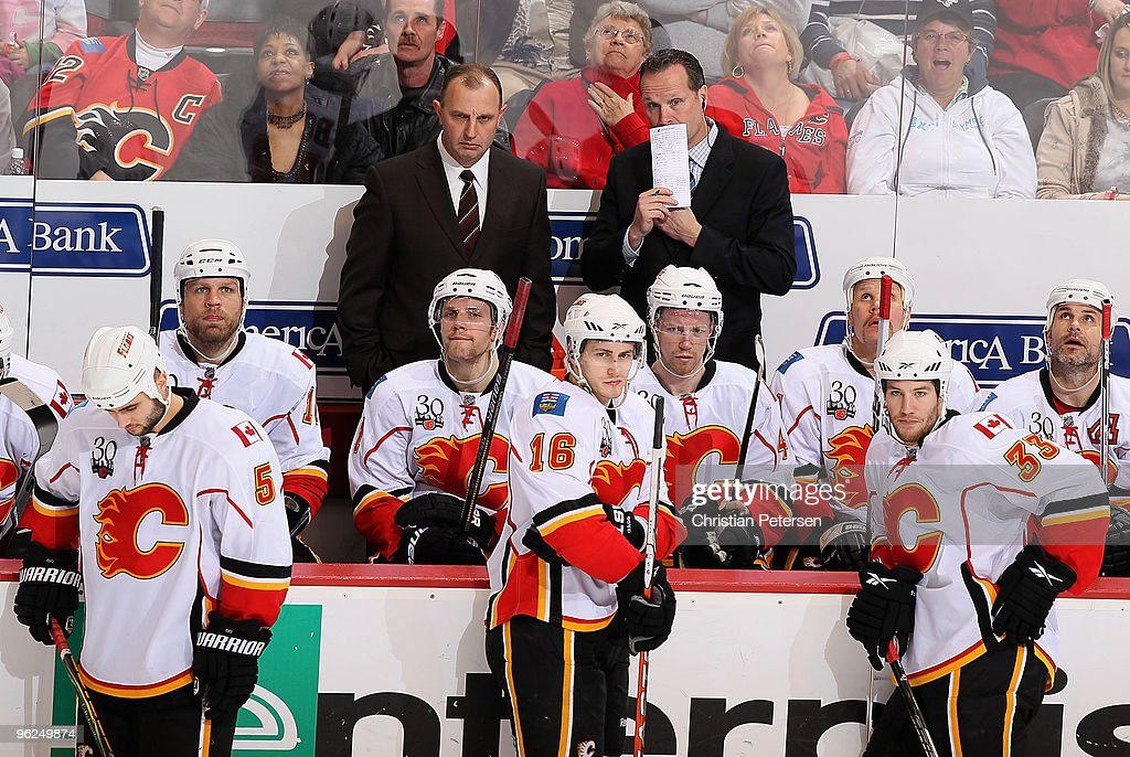 Head coach <a gi-track='captionPersonalityLinkClicked' href=/galleries/search?phrase=Brent+Sutter&family=editorial&specificpeople=1045160 ng-click='$event.stopPropagation()'>Brent Sutter</a> and the Calgary Flames bench react after a non goal was reviewed during the second period of the NHL game against the Phoenix Coyotes at Jobing.com Arena on January 28, 2010 in Glendale, Arizona. The Coyotes defeated the Flames 3-2 in an overtime shootout.