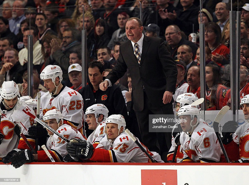 Head coach <a gi-track='captionPersonalityLinkClicked' href=/galleries/search?phrase=Brent+Sutter&family=editorial&specificpeople=1045160 ng-click='$event.stopPropagation()'>Brent Sutter</a> of the Calgary Flames stands on the bench to yell at referees during a game against the Chicago Blackhawks at the United Center on March 2, 2011 in Chicago, Illinois. The Blackhawks defeated the Flames 6-4.